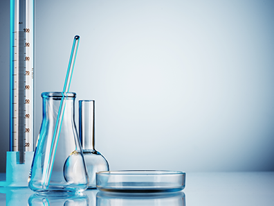 Five Blue Scientific Instruments Including a Beaker a Measuring Jug and a Thermometer