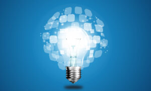 Lightbulb Floating in Front of a Blue Background